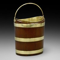A Dutch mahogany and brass bucket