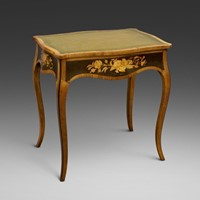 A fine marquetry inlaid writhing table