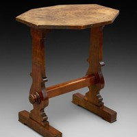 An unusual flame mahogany side table