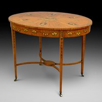 A superb Sheraton Revival oval center table
