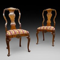 A Pair of George I style side chairs