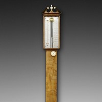 A George III mahogany bow-fronted stick barometer