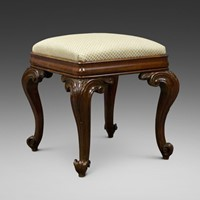 An extravagantly carved rosewood stool