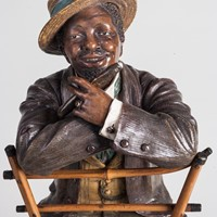 Terracotta Figure of a Cigar-Smoking Dandy