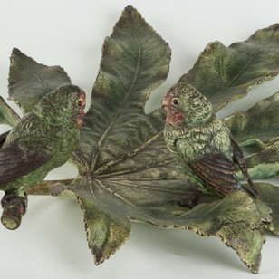 A Fine and Large Vienna Bronze Fig parrots on Leaf
